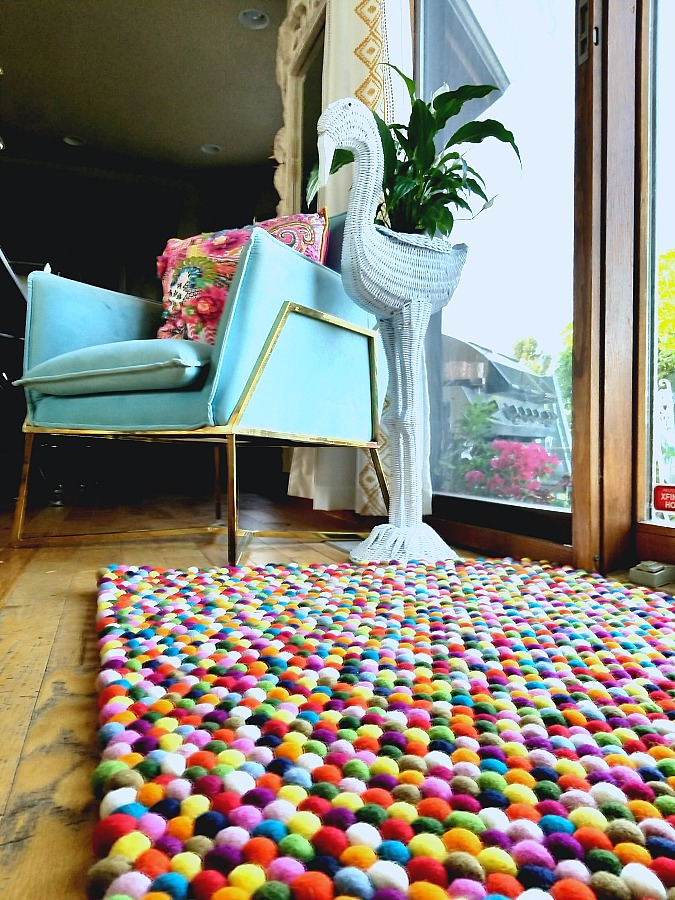 I'm in love it's like walking on marshmallows, felt ball rug, sukhi rugs, colorful rug, home decor, interior design, artisan made, fair trade, ethical design, eclectic,